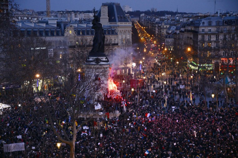 People gather on the Place de la Republique (Republic Square) in Paris during a Unity rally Marche Republicaine on January 11, 2015 in tribute to the 17 victims of a three-day killing spree by homegrown Islamists. The killings began on January 7 with an assault on the Charlie Hebdo satirical magazine in Paris that saw two brothers massacre 12 people including some of the country's best-known cartoonists, the killing of a policewoman and the storming of a Jewish supermarket on the eastern fringes of the capital which killed 4 local residents. (Bertrand Guay/AFP/Getty Images)