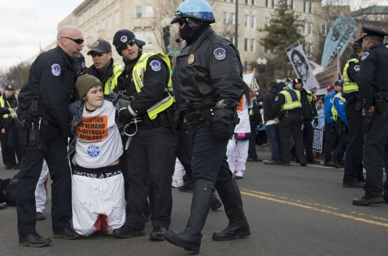 A pro-choice activist is arrested by US Capitol Police after blocking the road against the March For Life's path in front of the US Supreme Court in Washington, DC, January 22, 2015. (JIM WATSON/AFP/Getty Images)