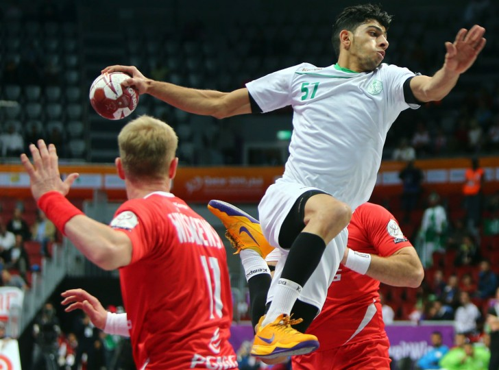 Saudi Arabia's Mojtaba al-Salem attempts a shot on goal during the 24th Men's Handball World Championships preliminary round Group D match between Poland and Saudi Arabia at the Duhail Handball Sports Hall in Doha on January 22, 2015. (AFP Photo/Marwan Naamani)