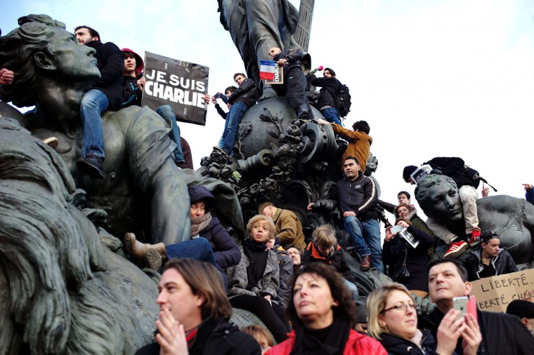 People gather at Place de la Nation during a rally in Paris, Sunday, Jan. 11, 2015. Hundreds of thousands gathered Sunday throughout Paris and cities around the world, to show unity and defiance in the face of terrorism that killed 17 people in Franceís bleakest moment in half a century. (AP Photo/Thibault Camus)