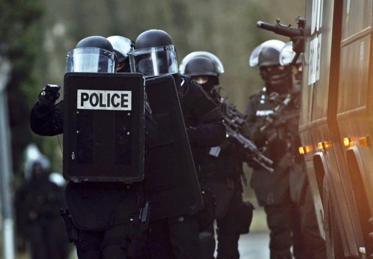 French police officers patrol in Longpont, north of Paris, France, Thursday, Jan. 8, 2015. Scattered gunfire and explosions shook France on Thursday as its frightened yet defiant citizens held a day of mourning for 12 people slain at a Paris newspaper. French police hunted down the two heavily armed brothers suspected in the massacre to make sure they don't strike again. (AP Photo/Thibault Camus)