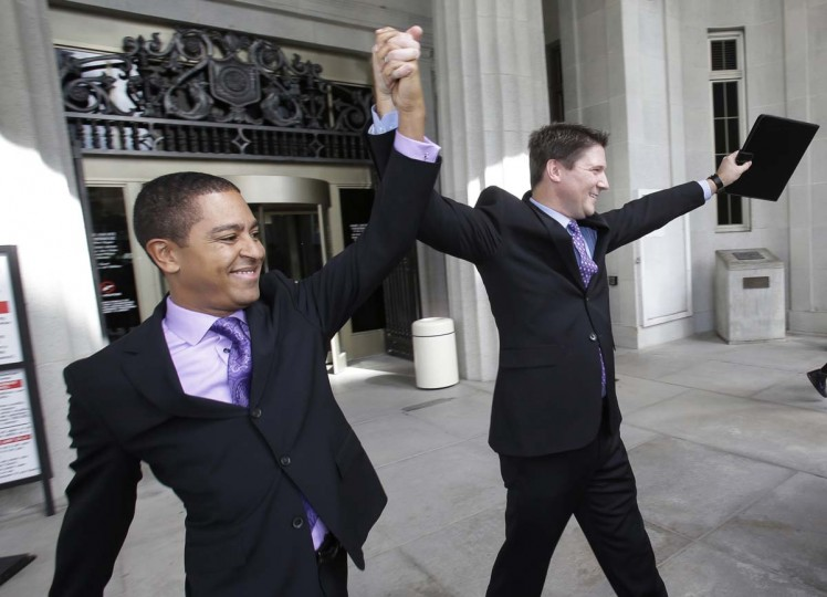Todd, left, and Jeff Delmay, celebrate as they leave the courthouse after having attended a hearing in which a Miami-Dade Circuit Judge cleared the way for gay and lesbian couples to marry, Monday, Jan. 5, 2015, in Miami. Judge Sarah Zabel provided a jump-start Monday to Florida's entry as the 36th state where gays and lesbians can legally marry, saying she saw no reason why same-sex couples couldn't immediately get their licenses in Miami-Dade County ahead of a midnight launch statewide. (AP Photo/Wilfredo Lee)