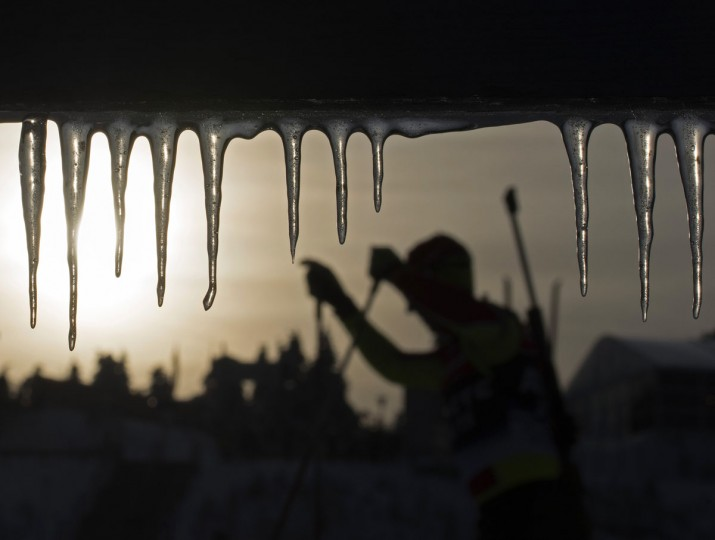A participant skis during the men's training behind icicles at the Biathlon World Cup in Oberhof, central Germany, Tuesday, Jan. 6, 2015. The Biathlon World Cup starts with the women's 4x5 kilometers relay race in Oberhof, Jan. 7, 2015. (AP Photo/Jens Meyer)