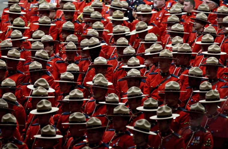 RCMP officers attend the funeral procession for slain Royal Canadian Mounted Police Constable David Wynn, in St. Albert, Alta., on Monday, Jan. 26, 2015. Wynn died four days after he and Auxiliary Constable Derek Bond were shot by Shawn Rehn in St. Albert, Alta, on Saturday, Jan. 17, 2015. (AP Photo/The Canadian Press, Jason Franson)
