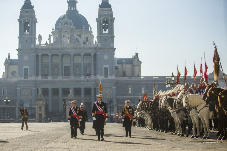 Spain's King Felipe VI, centre, reviews troops during the annual Pascua Militar Epiphany ceremony at the Royal Palace in Madrid, Spain, Tuesday, Jan. 6, 2015. (AP Photo/Andres Kudacki)