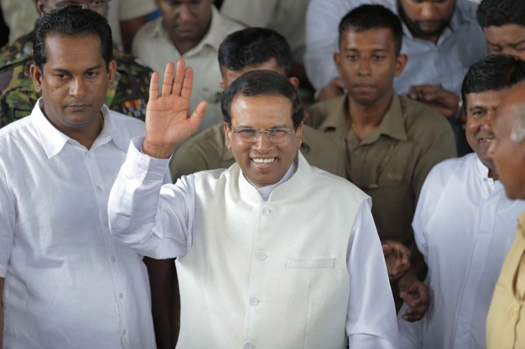 Sri Lanka incoming President Maithripala Sirisena waves to supporters as he leaves the election secretariat in Colombo, Sri Lanka, Friday, Jan. 9.  In a stunning election result that was unthinkable just weeks ago, Sri Lanka's longtime president acknowledged Friday that he had been defeated by a onetime political ally, signaling the fall of a family dynasty and the rise of former Cabinet minister Sirisena. (AP Photo/Eranga Jayawardena)