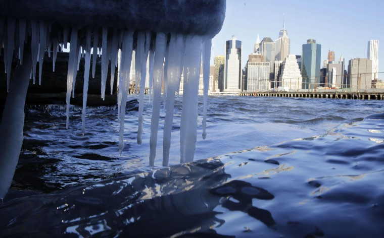 Icicles form on the waterfront in the borough of Brooklyn in New York on Thursday, Jan. 8, 2015. Cold air has sent temperatures plummeting into the single digits around the U.S., with wind chills driving them even lower. Lower Manhattan appears in the background. (AP Photo/Peter Morgan)