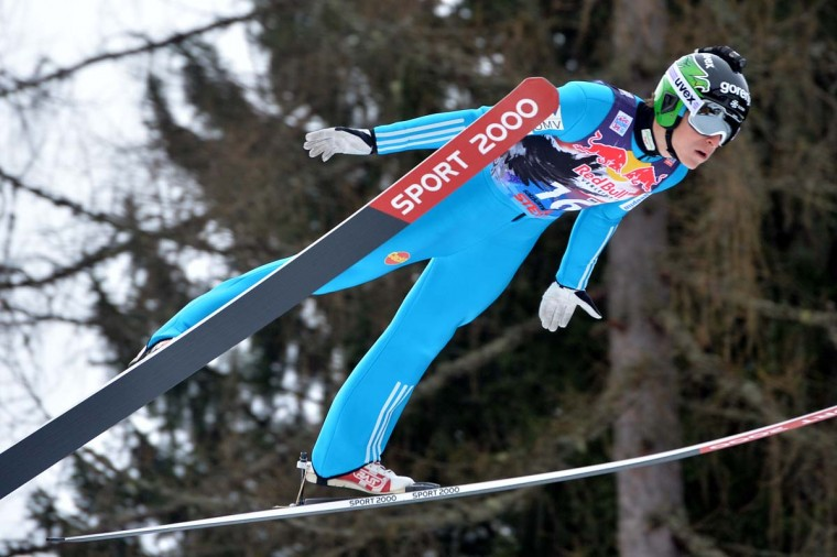 Slovenia's Jurij Tepes soars during the trial jump of  the Ski Jumping World Cup in Bad Mitterndorf, Austria, on Friday, Jan. 9. (AP Photo/Kerstin Joensson)