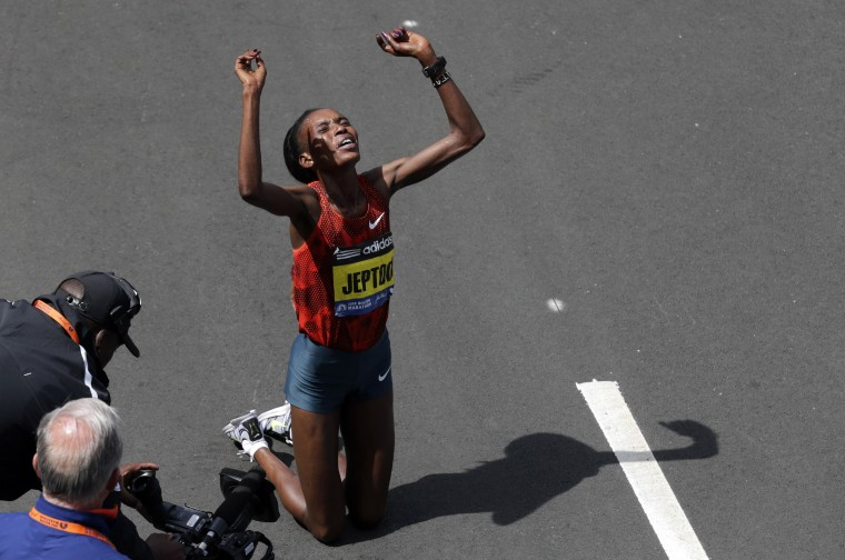 In this Monday, April 21, 2014 file photo, Rita Jeptoo of Kenya celebrates her win in the women's division of the 118th Boston Marathon in Boston. Athletics Kenya said on Friday, Jan. 30, 2015 that it has banned marathon champion Rita Jeptoo two years for doping after traces of the banned blood-booster EPO were found in her out-of-competition test in Kenya on Sept. 25. (AP Photo/Charles Krupa, File)