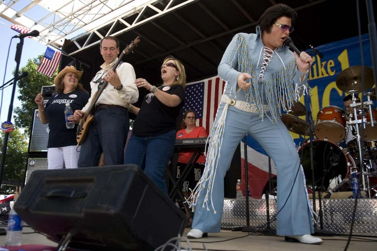 In this Aug. 11, 2007, file photo, presidential hopeful and former Arkansas Gov. Mike Huckabee, second from left, plays with his band, Capital Offense, as an Elvis impersonator from Duncan Hunter's campaign helps out with a rendition of Johnny-Be-Good at the Iowa Straw Poll in Ames, Iowa. The leaders of the Iowa Republican Party are set to meet Jan. 10 in Iowa, to decide whether to hold the increasingly controversial Straw Poll. Many top Republicans, including Gov. Terry Branstad, oppose the event, decrying it as an expensive sideshow, but it appears the party is likely to keep it in place. (AP Photo/David Lienemann, File)