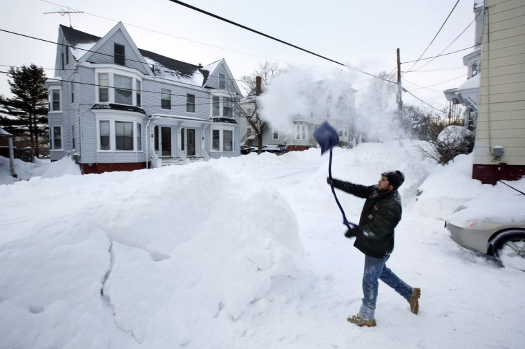 A man walks on a snow-covered sidewalk, Tuesday, Jan. 6, 2015, in Baltimore. The National Weather Service says snowfall totals could reach 4 to 6 inches in the Washington suburbs and 3 to 5 in the Maryland mountains. (AP Photo/Patrick Semansky)