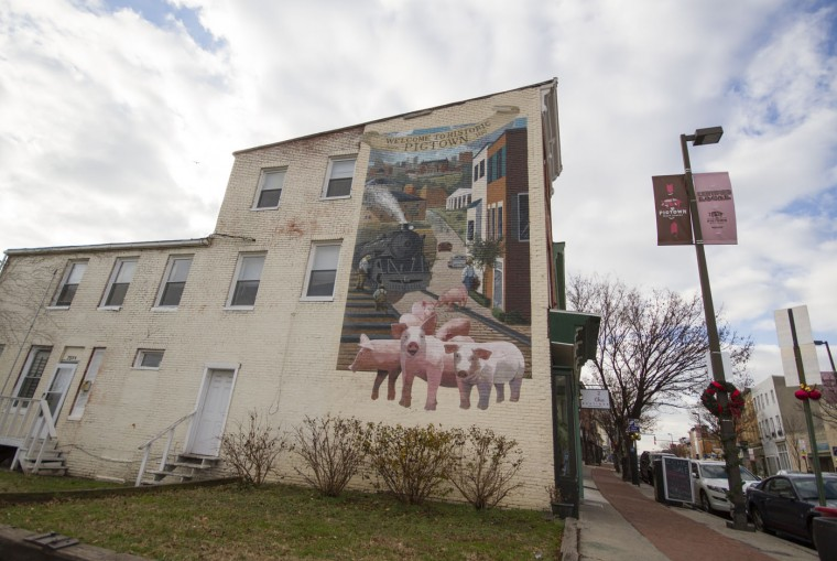 Dec. 2014: Murals depicting Pigtown's naming history along Pigtown's Main Street. Kalani Gordon/Baltimore Sun