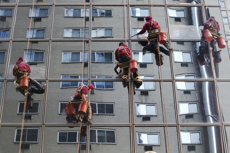 Workers with Jenkintown Building Services wash a skyscraper's windows Friday, Jan. 16, 2015, in the Center City section of Philadelphia. (AP Photo/Matt Rourke)