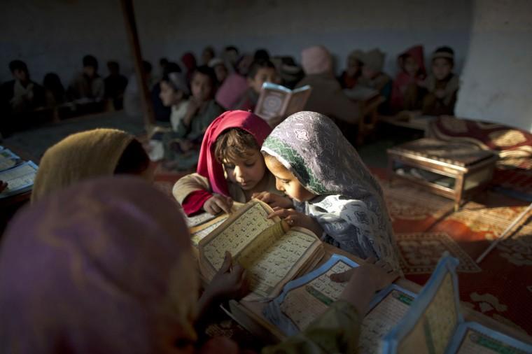 Internally displaced Pakistani children from tribal areas attend their daily Madrassa, or Islamic school on the outskirts of Islamabad, Pakistan, Monday, Jan. 19, 2015. (AP Photo/Muhammed Muheisen)