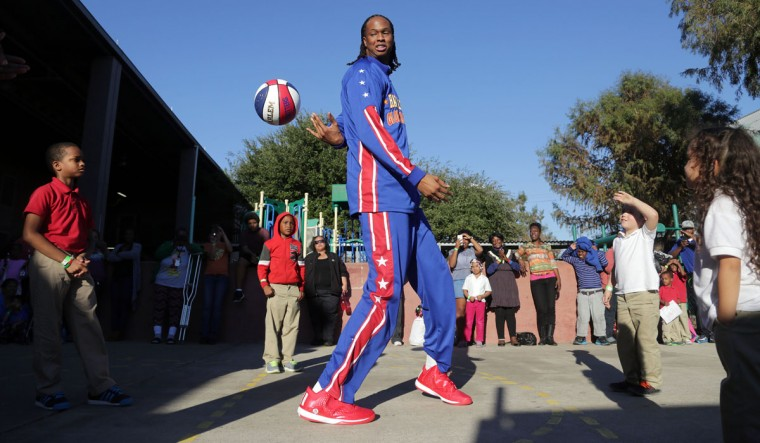 7-foot-4 Harlem Globetrotter Stretch Middleton shows off his ball handling skills at the Star for Hope Women & Family Emergency Shelter, Tuesday, Jan. 20, 2015, in Houston. (AP Photo/Houston Chronicle, Billy Smith II)