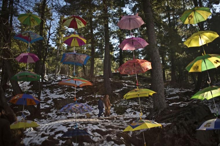 Umbrellas are displayed for sale by a Pakistani vendor on a roadside in Murree, Pakistan, Sunday, Jan. 25, 2015. (AP Photo/Muhammed Muheisen)