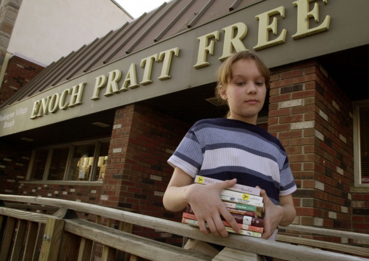 April 19, 2001: Lauren Iser, 13, of Baltimore, checks out books weekly from the Washington Village Branch of the Enoch Pratt Free Library in Pigtown. Kenneth K. Lam/Baltimore Sun