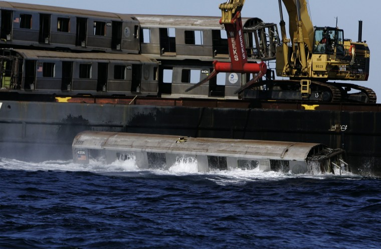 An old New York City subway car sinks into the Atlantic Ocean after it was dropped from a barge off the coast of Delaware, Tuesday, Oct. 7, 2008. The subway cars are used to form an underwater reef which is a habitat for sea creatures. (AP Photo/Mike Derer)