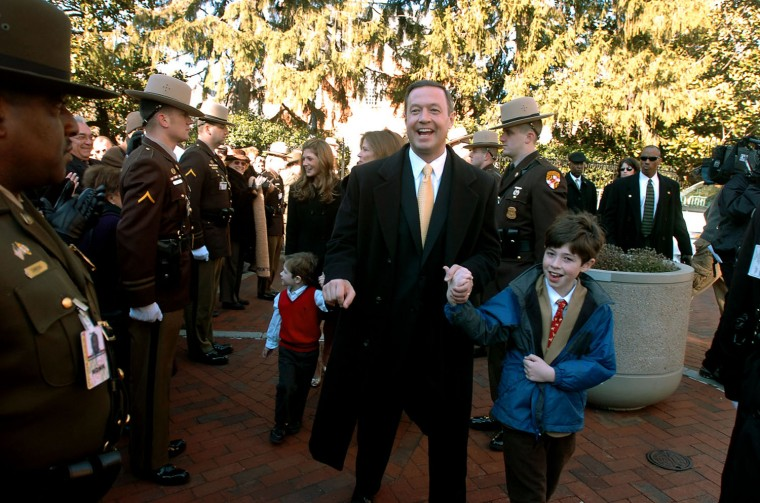 Martin O'Malley walks from Government House holding his son William O'Malley's hand as he is followed by the rest of his family. They are walking to the State House where O'Malley will be sworn in as Maryland's 61st governor in 2007. (Kim Hairston/Baltimore Sun)
