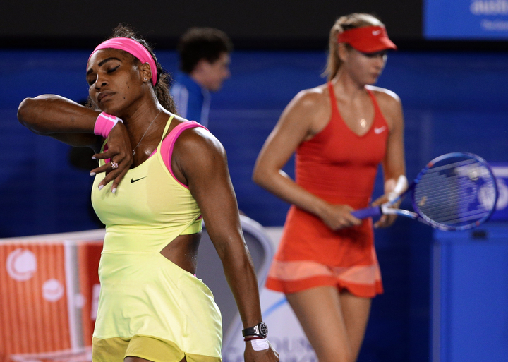 Serena Williams of the U.S., left, and Maria Sharapova of Russia change ends during the women's singles final at the Australian Open tennis championship in Melbourne, Australia. (Rob Griffith/AP Photo)
