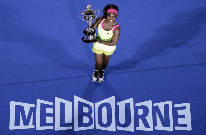 Serena Williams of the U.S. holds the trophy after defeating Maria Sharapova of Russia in the women's singles final at the Australian Open tennis championship in Melbourne, Australia. (Lee Jin-man/AP Photo)