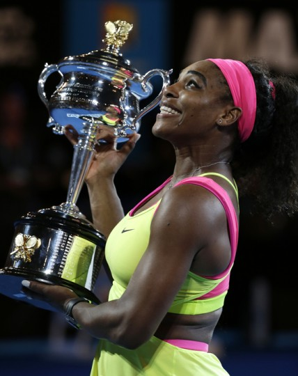 Serena Williams of the U.S. holds the trophy after defeating Maria Sharapova of Russia in the women's singles final at the Australian Open tennis championship in Melbourne, Australia. (Vincent Thian/AP Photo)