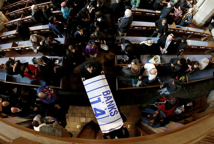 """The casket leaves the memorial service for Hall of Fame slugger Ernie Banks at Chicago's Fourth Presbyterian Church. Banks died Friday at 83 after a heart attack, according to an attorney representing his family. Known as """"Mr. Cub,"""" Banks is remembered as much for his boundless enthusiasm despite playing on mostly losing teams as his 512 home runs and two MVP awards. (Nam Y. Huh/AP Photo)"""