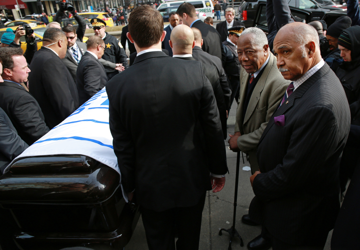 Pallbearers, including Billy Williams, right, and Hank Aaron, second from right, watch as the casket of Ernie Banks is moved into a hearse outside Fourth Presbyterian Church in Chicago. (John J. Kim/Chicago Tribune/TNS)