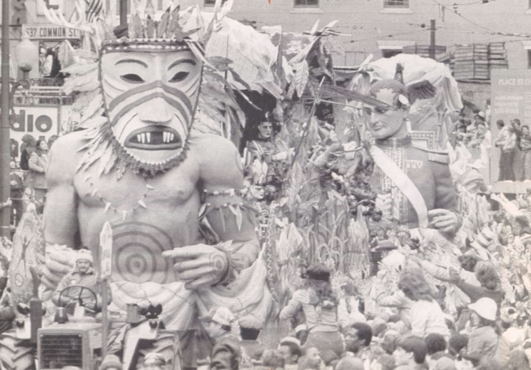 A giant figure with a mask dominates a float in the Krewe of Rex parade at Mardi Gras on March 6, 1984. Hundreds of thousands of revelers packed the streets of New Orleans despite dreary cold weather for the annual Fat Tuesday celebration. (Jerry Lodriguss/UPI)