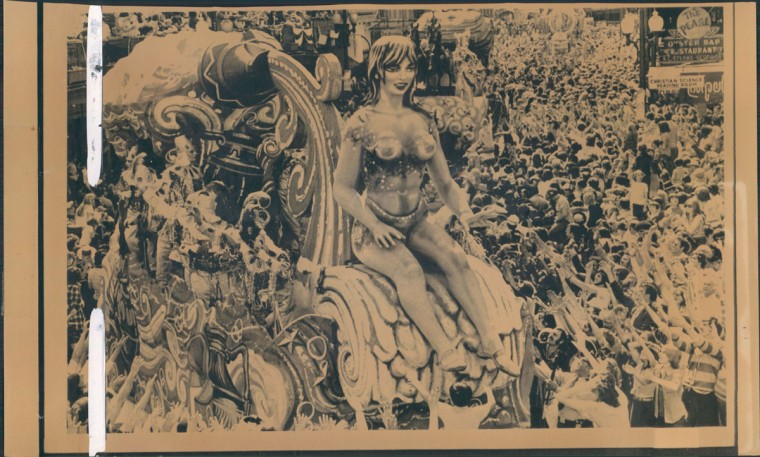 A giant painted lady sits atop a carnival float making its way onto Canal Street iN New Orleans on February 23, 1977. At least a million people crowded the streets to do their part for the Fat Tuesday celebration (AP Wirephoto)
