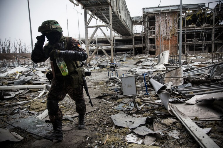 A pro-Russian rebel walks amongst the wreckage of the destroyed Donetsk airport on February 26, 2015 in Donetsk, Ukraine. The Donetsk airport has been one of the most heavily fought over pieces of land between the Ukrainian army and pro-Russian rebels. (Photo by Andrew Burton/Getty Images)