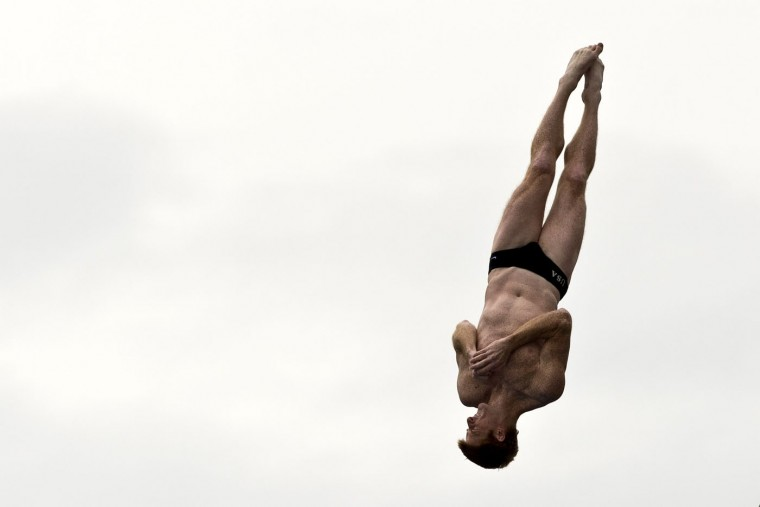 US Andy Jones dives from the 27-meter-high platform during the Red Bull Qualifier Cliff Diving World Series 2015 at the Pools Hernando Botero O'Byrne in Cali, department of Valle del Cauca, Colombia, on February 5, 2015. Luis Robayo/AFP/Getty Images