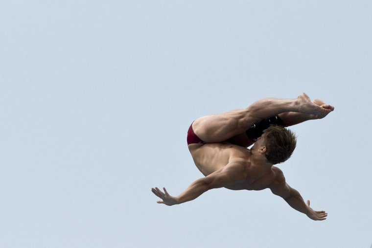 Ukrainian Anatoliy Shabotenko dives from the 27-meter-high platform during the Red Bull Qualifier Cliff Diving World Series 2015 at the Pools Hernando Botero O'Byrne in Cali, department of Valle del Cauca, Colombia, on February 5, 2015. Luis Robayo/AFP/Getty Images