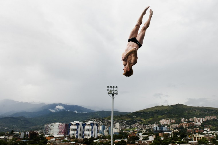 US Andy Jones dives from the 27-meter-high platform during the Red Bull Qualifier Cliff Diving World Series 2015 at the Pools Hernando Botero O'Byrne in Cali, department of Valle del Cauca, Colombia, on February 7, 2015. Luis Robayo/AFP/Getty Images