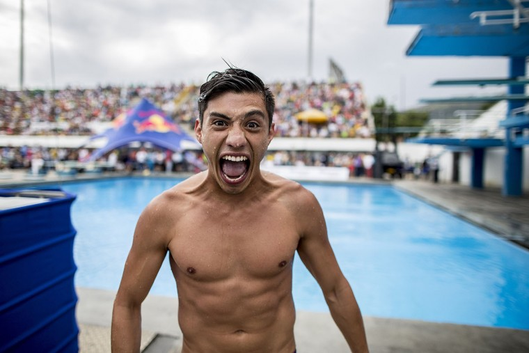 This handout photo received from Red Bull and taken on February 7, 2015 shows Jonathan Paredes of Mexico reacting after his final dive from the 27 metre platform during the final rounds of the Red Bull Cliff Diving World Series qualification competition at Piscinas Panamericanas, Cali, Colombia. Five divers, Jonathan Paredes of Mexico, Jucelino Junior of Brazil, Andy Jones of the USA, Blake Aldridge of the UK and Michal Navratil of the Czech Republic qualified and will join the five pre-qualified divers from last year in the 2015 season. Dean Treml/AFP/Red Bull/Getty Images