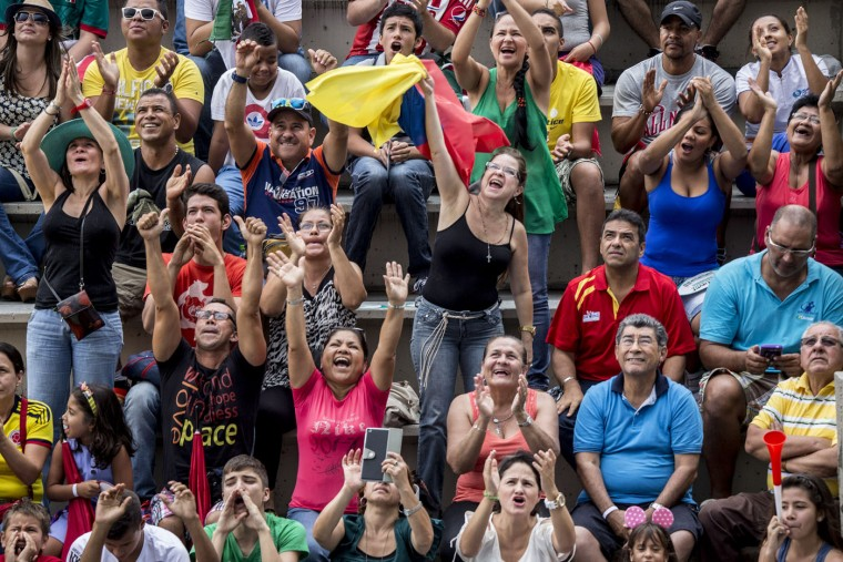 This handout photo received from Red Bull and taken on February 7, 2015 shows Colombian fans during the final rounds of the Red Bull Cliff Diving World Series qualification competition at Piscinas Panamericanas, Cali, Colombia. Five divers, Jonathan Paredes of Mexico, Jucelino Junior of Brazil, Andy Jones of the USA, Blake Aldridge of the UK and Michal Navratil of the Czech Republic qualified and will join the five pre-qualified divers from last year in the 2015 season. Dean Treml/AFP/Red Bull/Getty Images