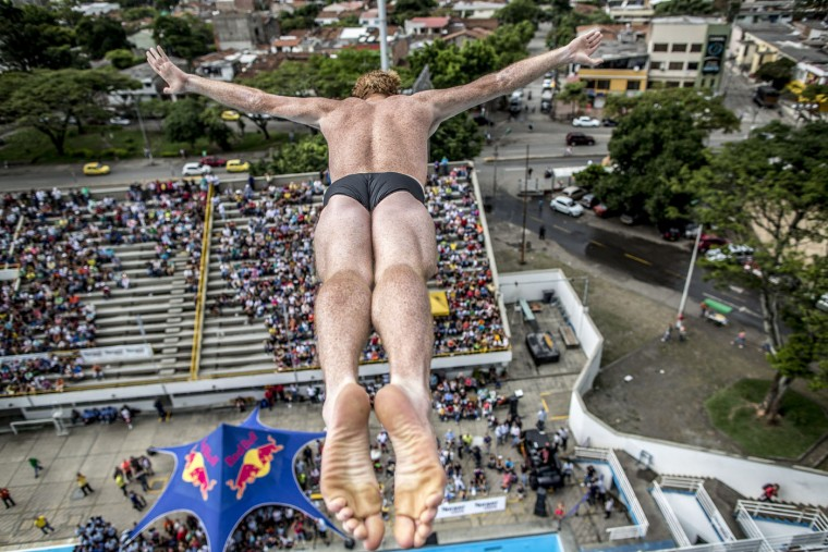 This handout photo received from Red Bull and taken on February 7, 2015 shows Andy Jones of the US diving from the 27 metre platform during the final rounds of the Red Bull Cliff Diving World Series qualification competition at Piscinas Panamericanas, Cali, Colombia. Five divers, Jonathan Paredes of Mexico, Jucelino Junior of Brazil, Andy Jones of the USA, Blake Aldridge of the UK and Michal Navratil of the Czech Republic qualified and will join the five pre-qualified divers from last year in the 2015 season. Dean Treml/AFP/Red Bull/Getty Images