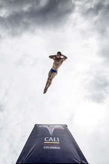 This handout photo received from Red Bull and taken on February 7, 2015 shows Michal Navratil of the Czech Republic diving from the 27 metre platform during the final rounds of the Red Bull Cliff Diving World Series qualification competition at Piscinas Panamericanas, Cali, Colombia. Five divers, Jonathan Paredes of Mexico, Jucelino Junior of Brazil, Andy Jones of the USA, Blake Aldridge of the UK and Michal Navratil of the Czech Republic qualified and will join the five pre-qualified divers from last year in the 2015 season. Dean Treml/AFP/Red Bull/Getty Images