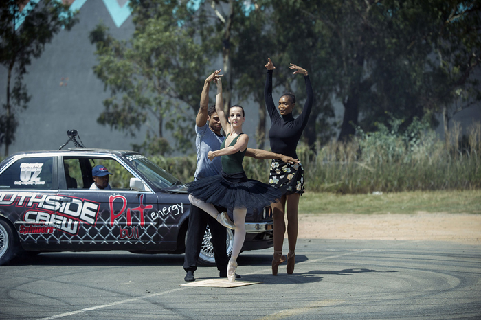 Johannesburg Ballet dancers perform on Tuesday in the Pirouette challenge in Soweto while Sparky, a street racer, makes doughnuts spins around the dancers. The challenge entices people to film their take on the pirouette and upload the video onto social media platforms. (MUJAHID SAFODIENMUJAHID SAFODIEN/AFP/Getty Images)