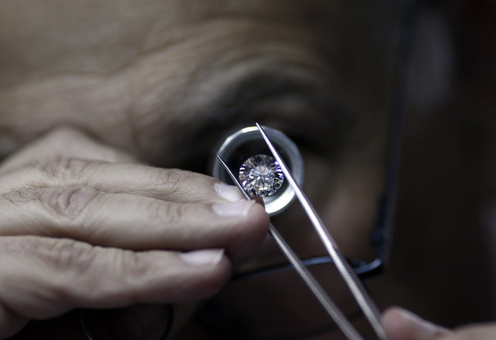 An Israeli diamonds buyer checks the quality of a diamond during the International Diamond Week on Tuesday in the Israeli city of Ramat Gan, east of Tel Aviv. (THOMAS COEX/AFP/Getty Images)