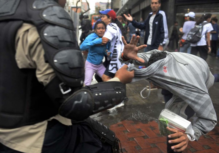 An opponents to Venezuelan President Nicolas Maduro is arrested during a protest in Caracas, Venezuela on February 12, 2015. Opposition students marched Thursday in Caracas and other Venezuelan cities.     CREDIT: FEDERICO PARRA - AFP/GETTY IMAGES