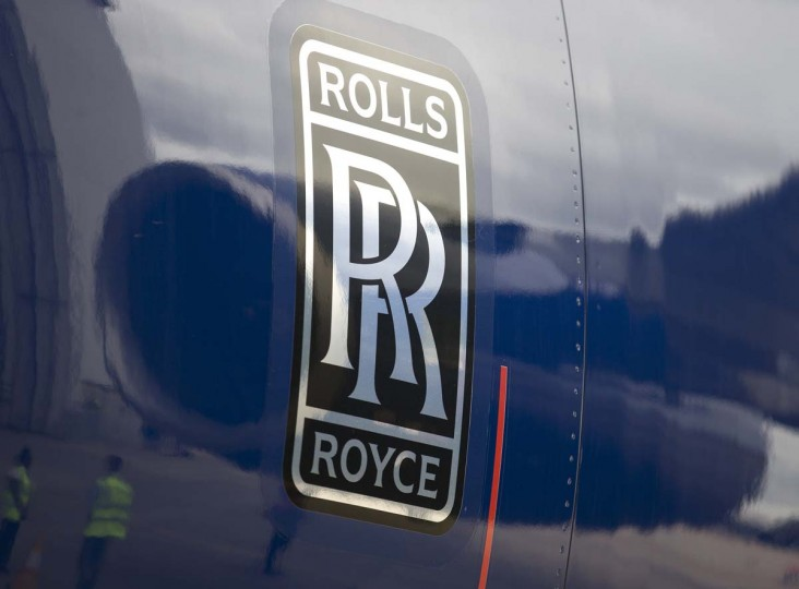 A picture taken on July 4, 2013 shows a reflection of a Rolls Royce Trent 900 turbofan engine at Heathrow Airport in London. British engine maker Rolls-Royce on February 13, 2015 slashed its earnings forecasts, blaming tumbling oil prices which have hurt revenues at its marine offshore division.     CREDIT: JUSTIN TALLIS - AFP/GETTY IMAGES