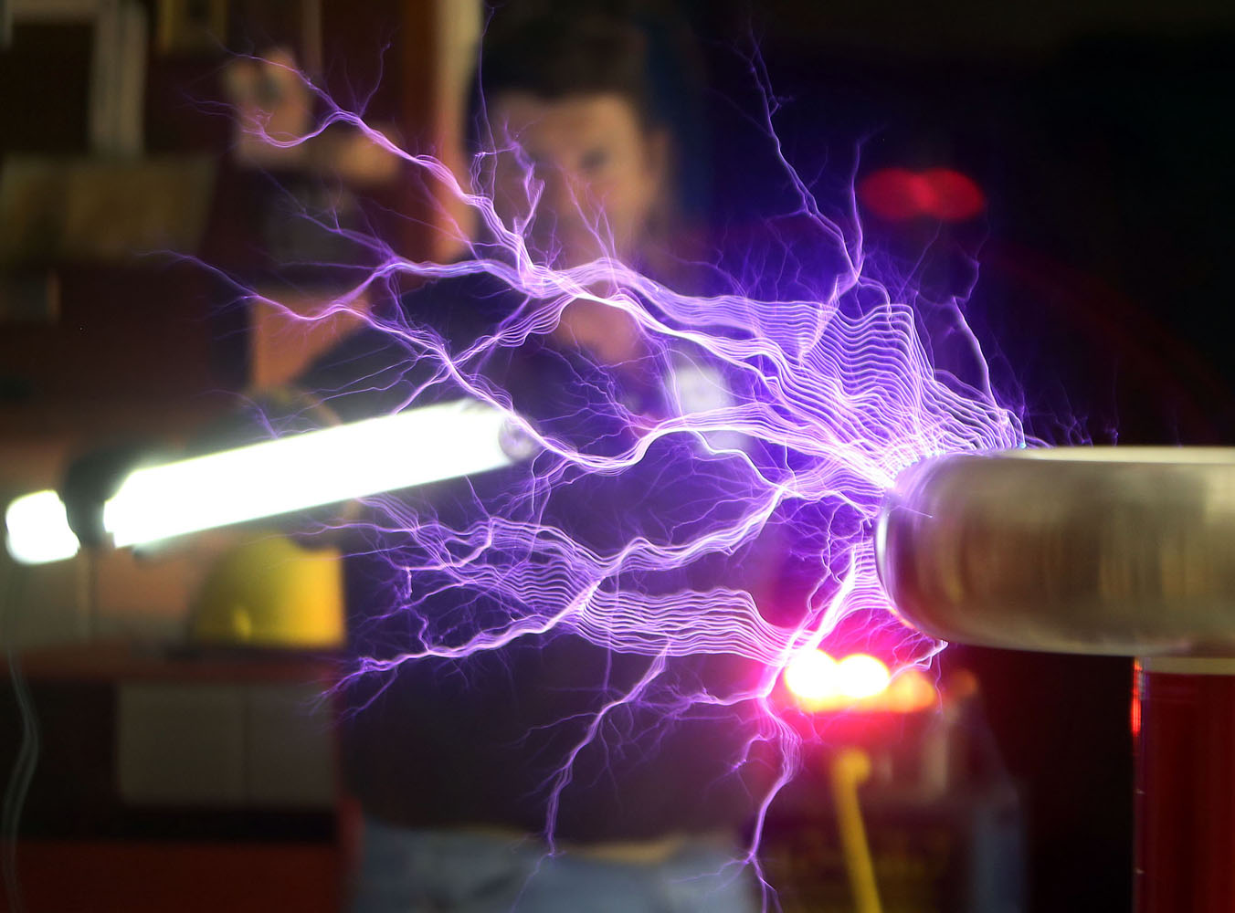 Tesla coil light, Madrid student protest, Milan Fashion Week | Feb. 26