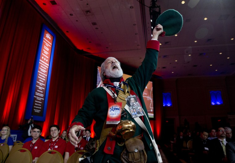 Golden Isles Tea Party activist William Temple, from Brunswick, Ga., dressed as Button Gwinnett, cheers as Ben Carson speaks during the Conservative Political Action Conference (CPAC) in National Harbor, Md., Thursday, Feb. 26, 2015. Button Gwinnett, of Georgia, was a signer of the Declaration of Independence. (Carolyn Kaster/AP Photo)