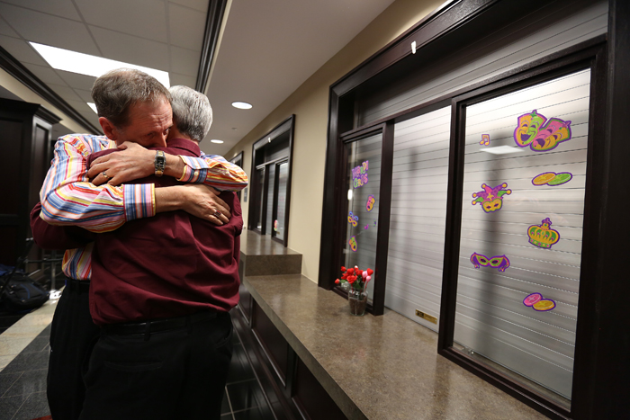 "Robert Povilat, left, and Milton Persinger, comfort each other after hearing that for a second day, the Mobile County Probate office won't issue marriage licenses on Tuesday in Mobile, Ala. A federal judge's ruling went into effect Monday overturning Alabama's ban on gay marriage after the U.S. Supreme Court refused the state's request to stop the marriages.  Alabama Chief Justice Roy Moore directed probate judges to refuse the licenses and resist what he called an ""illegal"" intrusion by the federal court. (Sharon Steinmann/AL.com/AP)"