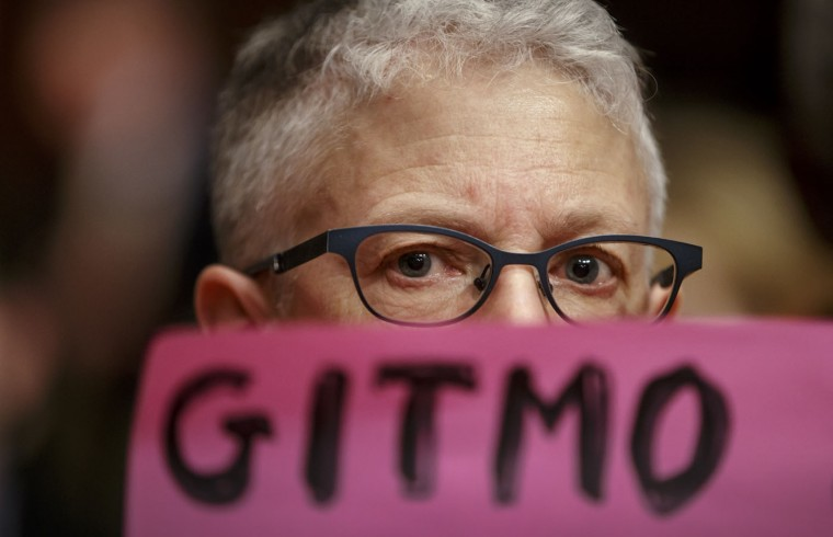 Ellen Sturtz, an activists from the antiwar group CodePink, participates in a silent protest on Capitol Hill in Washington, Thursday, Feb. 5, 2015, during a Senate Armed Services Committee hearing on the detention center in Guantanamo, Cuba/ A week ago, the same group drew the ire of Armed Services Chairman Sen. John McCain, R-Ariz., when they interrupted a hearing with former Secretary of State Henry Kissinger and charged the witness table. (AP Photo/J. Scott Applewhite)