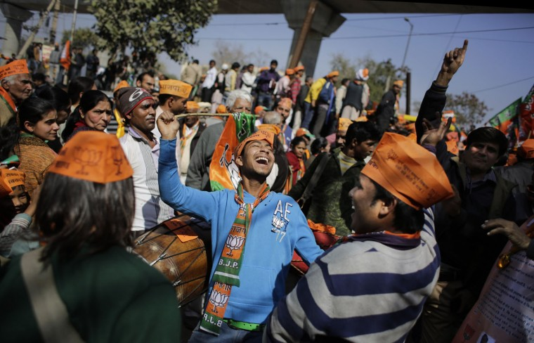 Supporters of India's ruling Bharatiya Janata Party (BJP) dance during an election campaign rally for the Delhi state election in New Delhi, India, Thursday, Feb. 5, 2015. The election is scheduled for February 7. (AP Photo/Altaf Qadri)