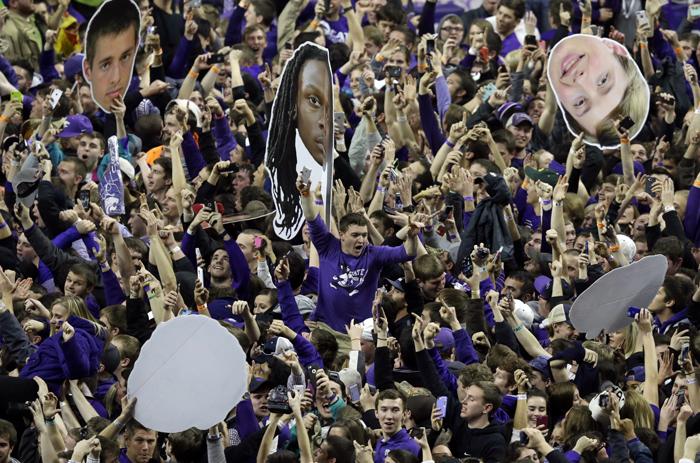 Kansas State fans celebrate victory following a basketball game against Kansas at Bramlage Coliseum in Manhattan, Kan., Monday. Kansas State defeated Kansas 70-63. (Orlin Wagner/AP)
