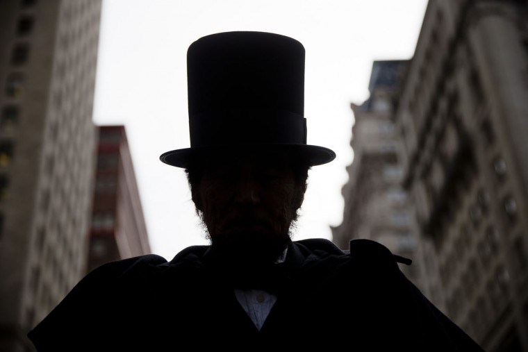 James Hayney portraying President Abraham Lincoln, takes part in a parade organized by the Union League of Philadelphia for the former president's birthday, Thursday, Feb. 12, 2015, in Philadelphia. 206 years has passed sense Lincoln was born in 1809. (Matt Rourke/AP)