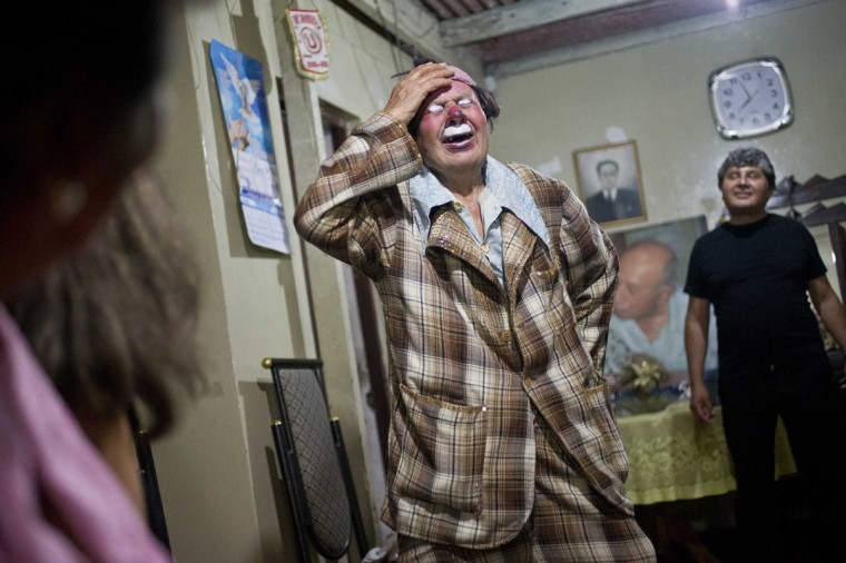 "Veteran clown Ricardo Farfan, popularly known as ""Pitito,"" performs during his 91st birthday party at his home in Lima, Peru. Farfan said he most liked being a clown while growing up in his father's circus, which he took over in the 70s, and that a clown has to be humble, speak from the heart and give joy to all ages. He added his disappointment with some clowns today who are vulgar with their audience. (AP Photo/Esteban Felix)"